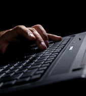 Man's hands on keyboard. Image courtesy of Shutterstock