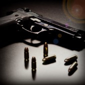 Image of gun courtesy of Shutterstock. Filters applied.