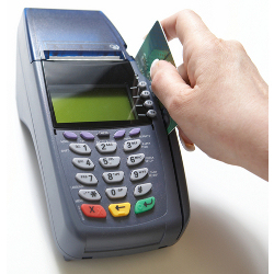 Image of credit card terminal courtesy of Shutterstock