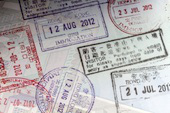 Passport stamps image courtesy of Shutterstock