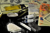 Image of drugs and money courtesy of Shutterstock